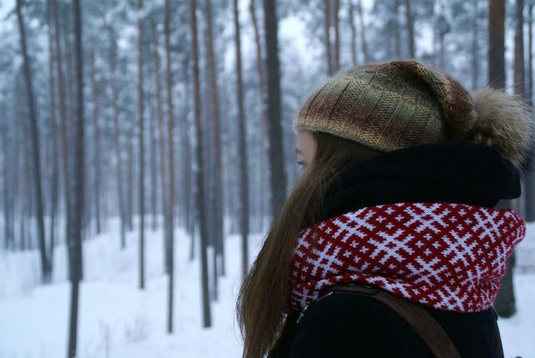 Woman Wearing Hat In Forest During Winter