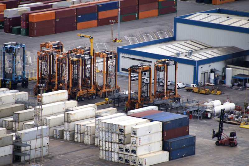 Row of industry in building with cargo container at commercial dock