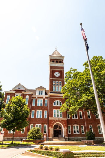 Clemson Clemson Football Clemson Tigers Architecture Building Building Exterior Built Structure Clemson University Clock Tower Day Flag History Low Angle View Nature No People Outdoors Patriotism Plant Sky Spire  The Past Tower Tree