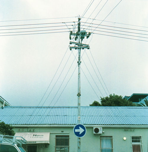 Architecture Building Building Exterior Built Structure Cable City Complexity Connection Day Electricity  Electricity Pylon Film Photography Fuel And Power Generation Low Angle View Nature No People Outdoors Power Line  Power Supply Sky Technology Telephone Line Transportation