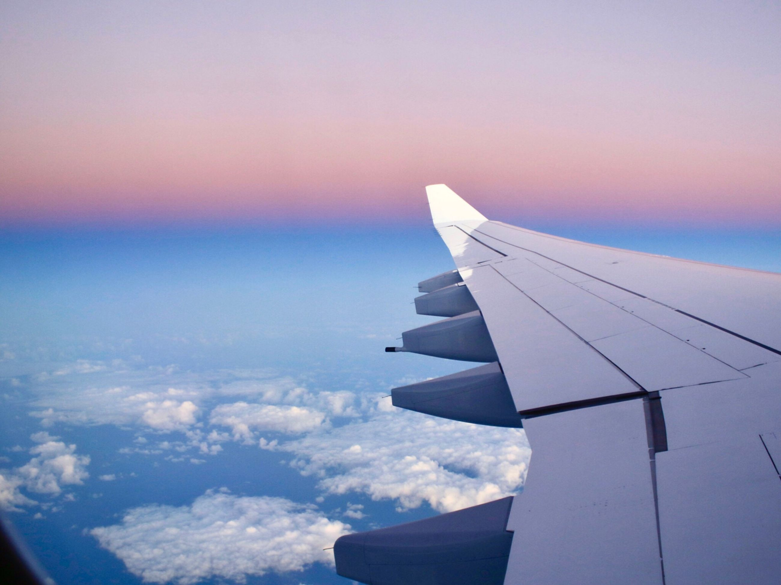 airplane, aircraft wing, flying, aerial view, sky, cloud - sky, travel, nature, journey, transportation, cloudscape, commercial airplane, outdoors, air vehicle, beauty in nature, sunset, no people, scenics, plane, day, cityscape, airplane wing