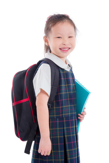 School Girl Isolated Backpack Uniform White Kid Little Background Child Education Portrait Kids Cute SchoolGirl Happy Smile Student Beautiful One Youth Schoolbag Bag Female person Pupil Pretty Study Preschool Childhood Standing Learn Knowledge Holding Young Studying Asian  Chinese Korean Thai Book
