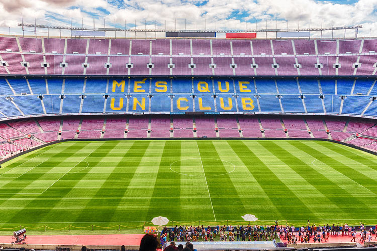 BARCELONA - AUGUST 11: Interior view of Camp Nou stadium, home of Barcelona Football Club, Catalonia, Spain, on August 11, 2017. With a seating capacity of 99,354 it is the largest stadium in Europe Crowd Group Of People Stadium Sport Large Group Of People Real People Spectator Architecture Competition Professional Sport Team Sport Day Grass Men Soccer Athlete Women Leisure Activity Event Outdoors Watching