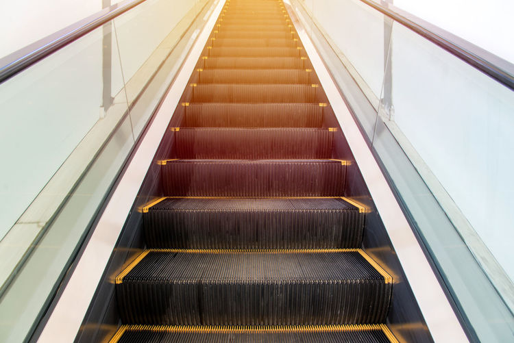 Staircase Railing Architecture Escalator Steps And Staircases Modern Convenience Low Angle View Direction No People Indoors  The Way Forward Transportation Futuristic Built Structure Moving Up Technology Metal Motion Empty Moving Walkway