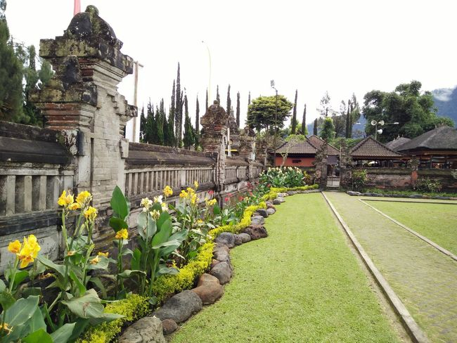 Architectural Column Architecture Built Structure Day Flower Grass Green Color History No People Outdoors The Past Tourism Travel Destinations Bedugulbali Bedugul Temple Bali, Indonesia Bedugul