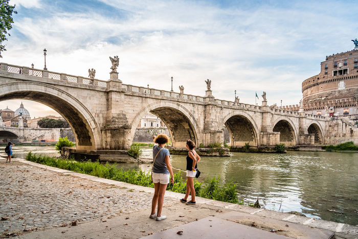 Castel Sant Angelo bridge and river at sunset Arch Architecture Bridge Bridge - Man Made Structure Building Exterior Built Structure Castel Castle Day Fortress History Iconic Buildings Iconic Landmark Italy Landmark Mausoleum Outdoors Real People River Roma Sunset Togetherness Travel Travel Destinations Water