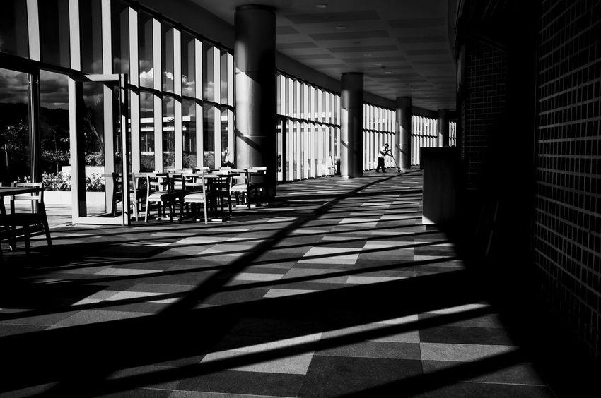 Fujifilm X100. Feb 2016. SM Seaside City Mall, Cebu City. Showcase March Street Photography Eyem Philippines FujiFilm X100 Monochrome Philippines Cebu City Fujifilm_xseries Indoors  Window Shadows Light And Shadow Monochrome Photography