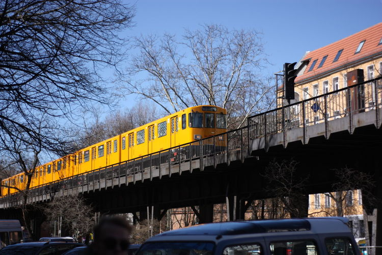 Low angle view of train on bridge against clear sky