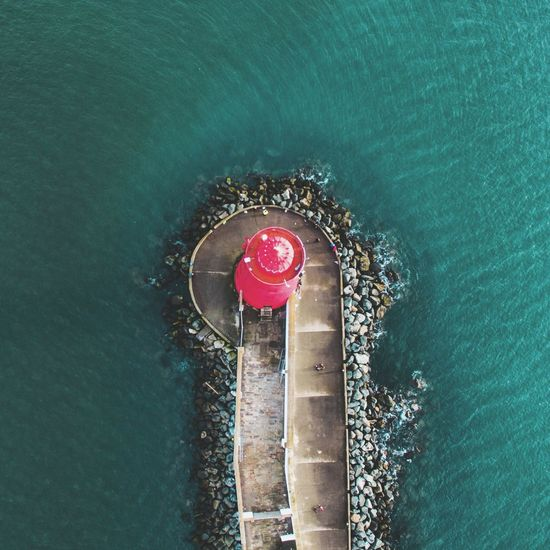 Eagle eye, Lighthouse 🚁 High Angle View Water No People Sea Red City Taking Photos Photograph Built Structure Lifestyles Cityscape Droneporn Ligthhouse Droneoftheday Dronelife Drone Panorama Dronepic Dronephotography