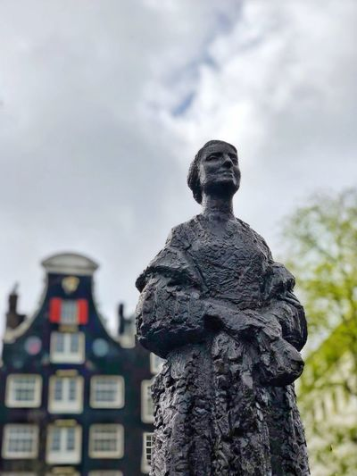 Netherlands Holland Amsterdam Statue Sculpture Human Representation Representation Art And Craft Male Likeness Sky Creativity Architecture Low Angle View Day No People Focus On Foreground Building Exterior Building History