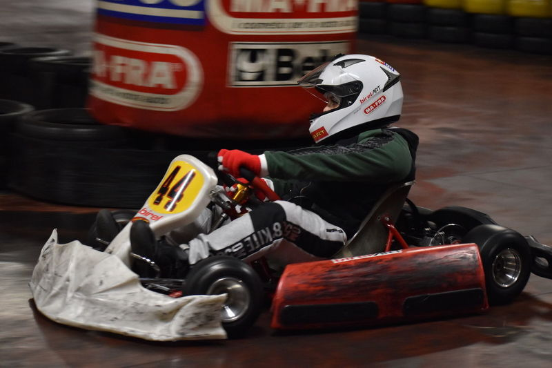 Go Kart One Person Helmet Indoors  Sport Sitting Crash Helmet Sports Race Communication Full Length Motorsport Toy Sports Helmet Protection Focus On Foreground Real People Sign Security Competition Headwear Motor Racing Track