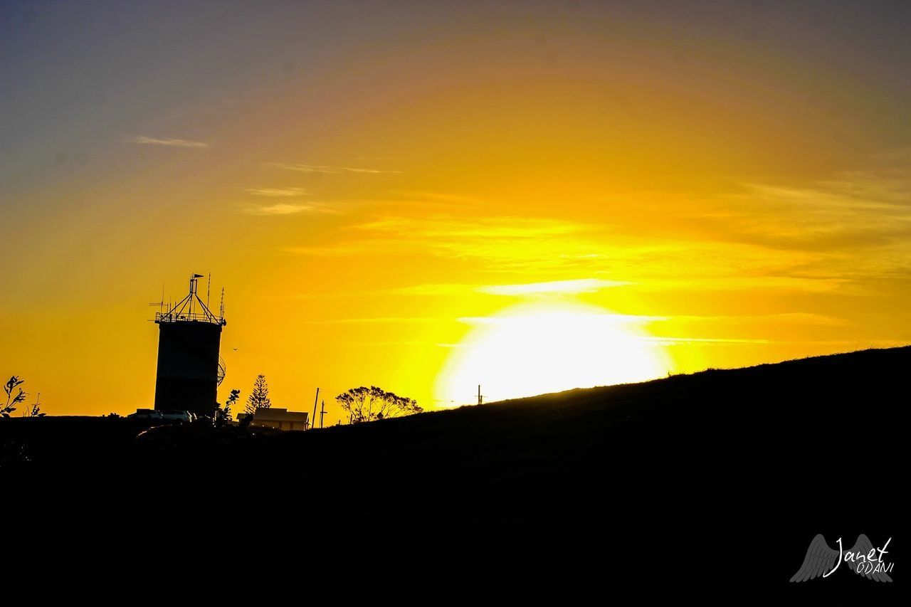 sky, silhouette, sunset, architecture, built structure, building exterior, orange color, cloud - sky, nature, no people, tower, building, beauty in nature, outdoors, scenics - nature, sunlight, environment, guidance, tranquility, tranquil scene