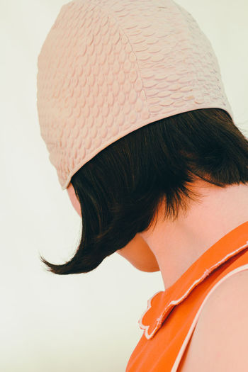 Bob Brunette Close-up Fashion Hair Style Haircut Headshot Looking Away Orange Color Pastel Colors Pastel Power Profile Studio Shot Swimming Caps The Portraitist - 2016 EyeEm Awards Unrecognizable Person Vintage Woman