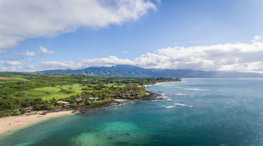 Aerial view of the coastline on the north shore of Oahu Hawaii North Shore Oahu Ocean View Aerial View Beauty In Nature Blue Cloud - Sky Day Hawaiian Islands High Angle View Horizon Over Water Idyllic Landscape Mountain Nature No People Outdoors Scenics Sea Sky Tranquil Scene Tranquility Travel Destinations Tree Tropical Beach Water
