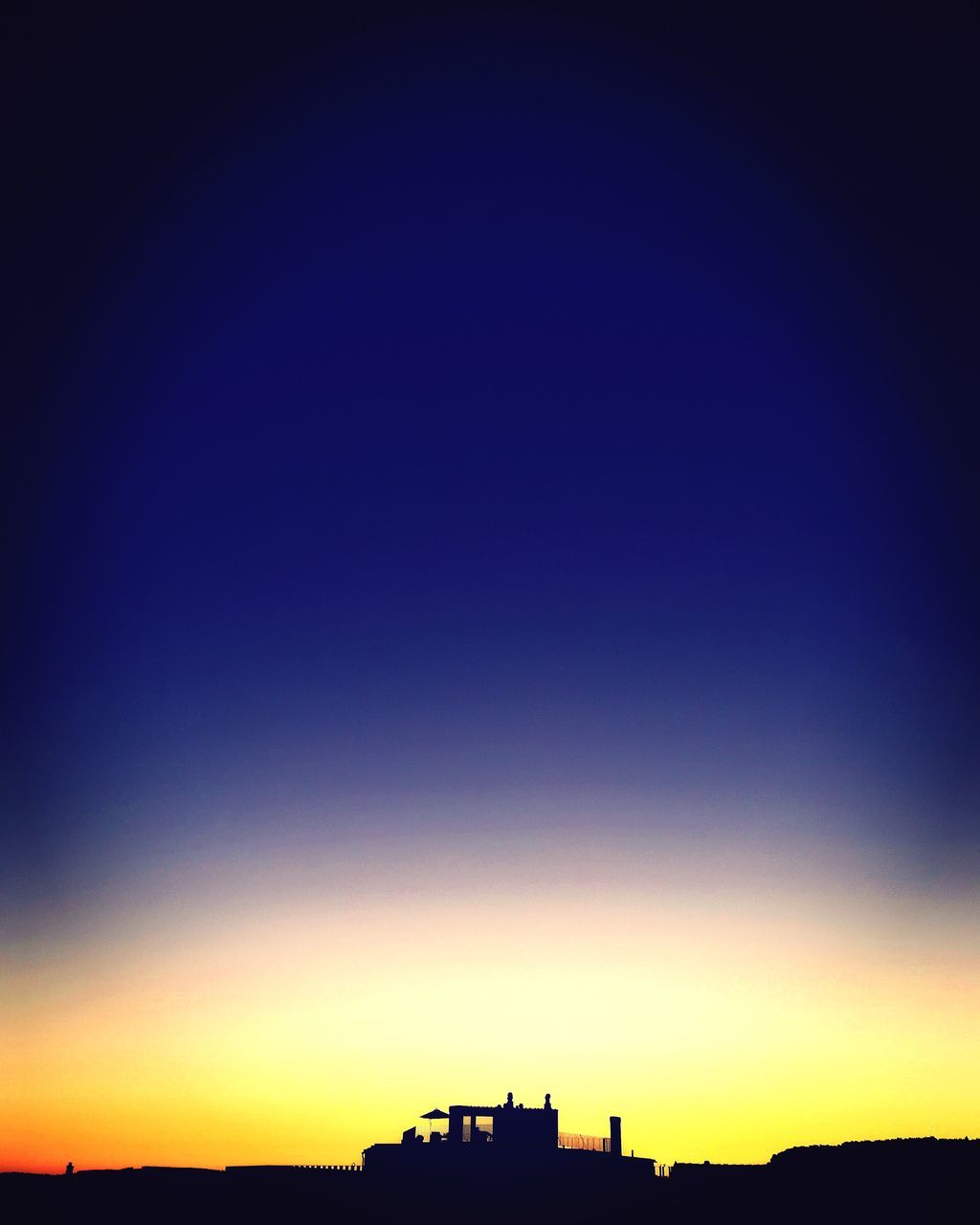 silhouette, blue, built structure, copy space, architecture, sunset, building exterior, nature, beauty in nature, outdoors, no people, sky, scenics, clear sky, day, vapor trail