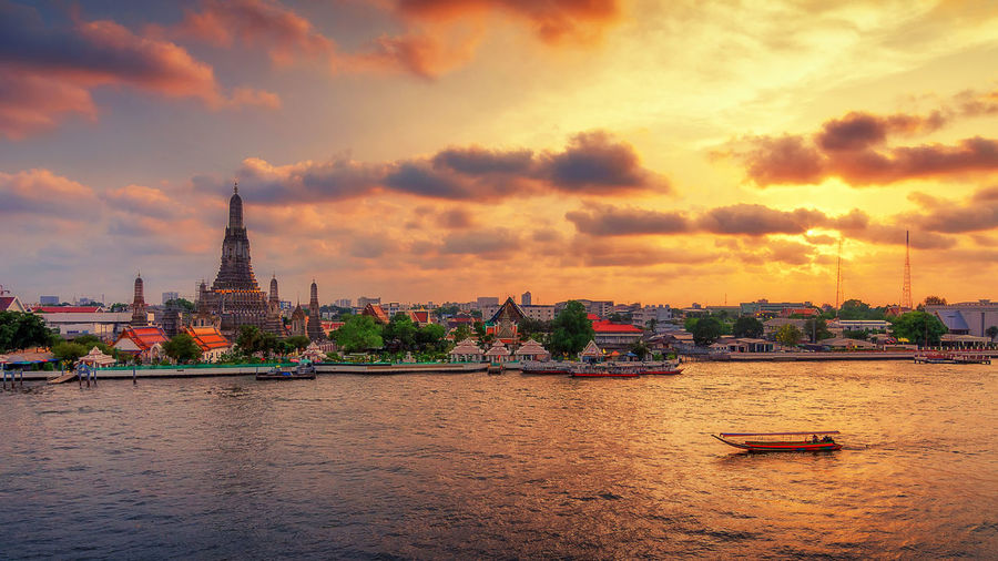 Wat Arun temple in Bangkok. Thailand is the oldest archaeological site at sunset Bangkok Wat Arun Temple Thailand HDR Panorama Dawn River Landmark Travel ASIA Place Phraya Twilight Background Skyline Water Night Architecture Tourism Religion Famous Cityscape Vacations Buddhism Stupa