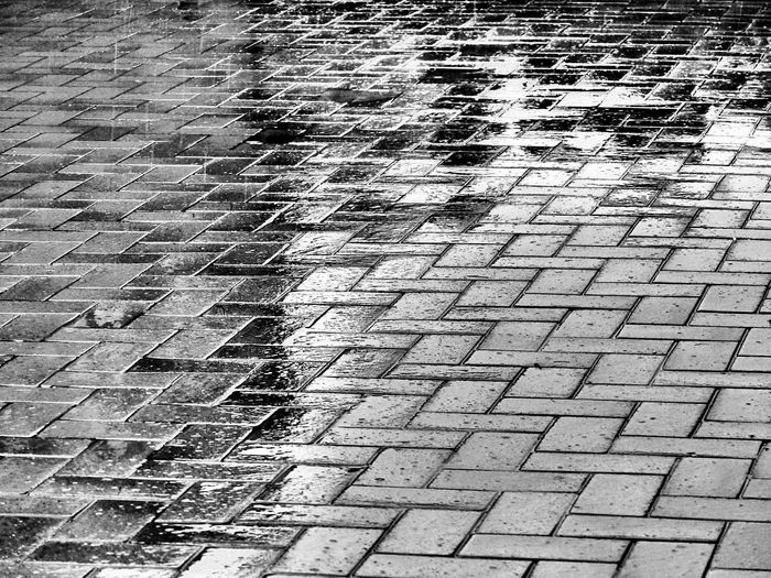 Full Frame Pattern Backgrounds No People Street High Angle View Day Footpath City Textured  Outdoors Sunlight Shadow Nature Cobblestone Close-up Paving Stone Flooring Architecture Stone Rain Tiled Floor Rainy Days Blackandwhite Black & White