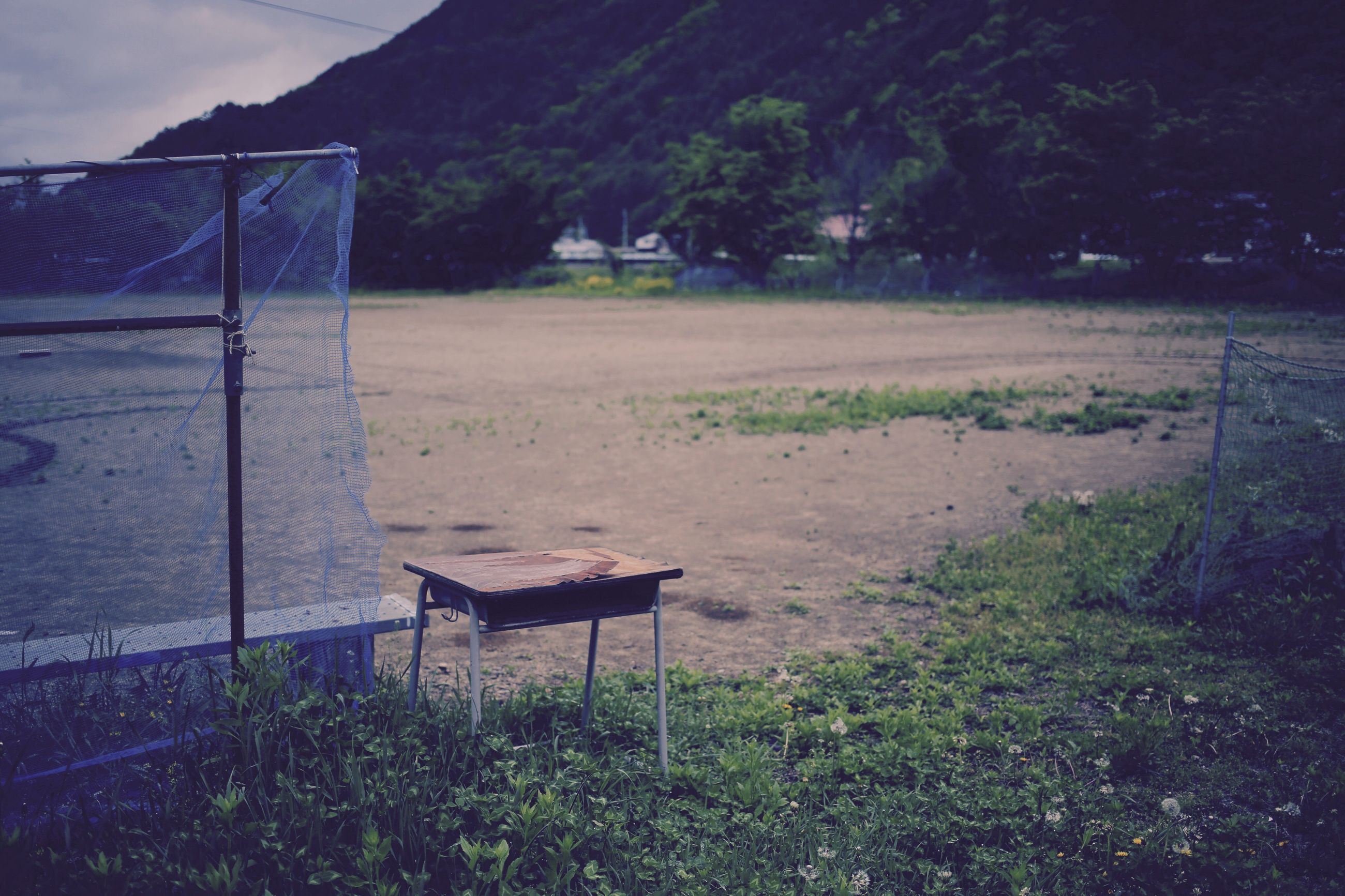 empty, field, chair, grass, absence, soccer, no people, outdoors, day, soccer field, sport, nature, playing field, tree, goal post, sky