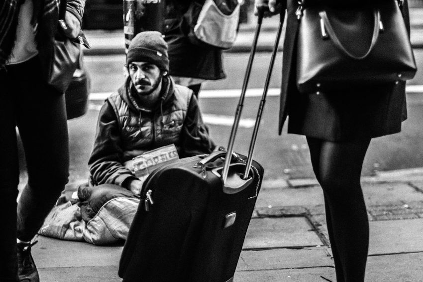 G O D. B L E S S Sitting Homeless Beggar Kindness Station Bnw Bnw_collection Outdoors Travel Commute Traveller Foreign Deep Eyes Capture Lonely Journey