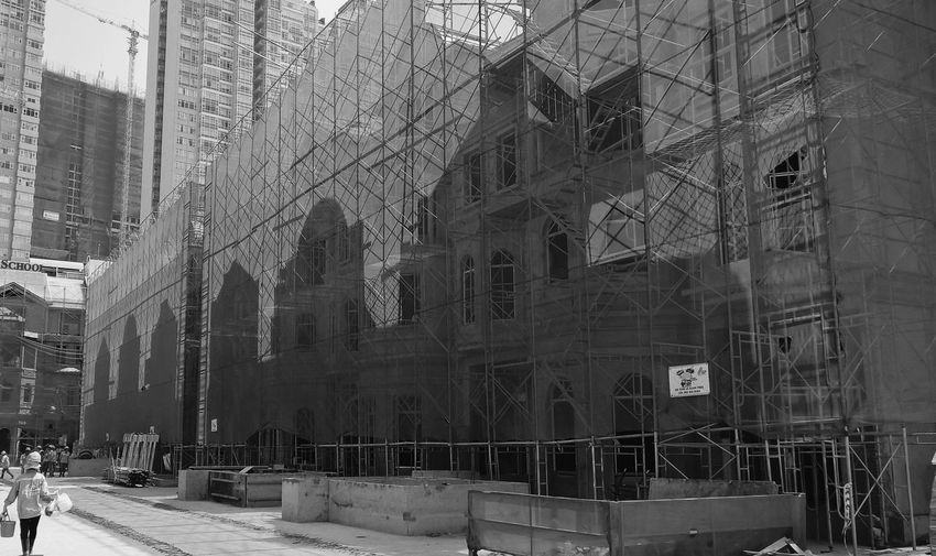 Shadow over Shape Tangled Row House Blackandwhite Blackandwhite Photography Outdoor Photography Outdoors Shadow Reflection Outline Shape City Architecture Building Exterior Built Structure Scaffolding Construction Site Construction Building Incomplete Architectural Style Urban Scenery Construction Frame Settlement Geometric Shape Urban Skyline Development Building - Activity The Architect - 2018 EyeEm Awards Construction Equipment Focus On Shadow