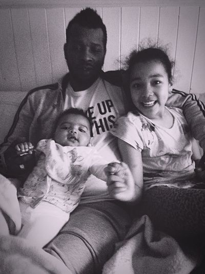 Family Blackandwhite Lifestyles Togetherness Sofa Home Interior Childhood Bonding Leisure Activity Sibling Looking At Camera Real People Sitting Indoors  Happiness Pets Baby Friendship Portrait Father Daughter Moments Sisters Smiling