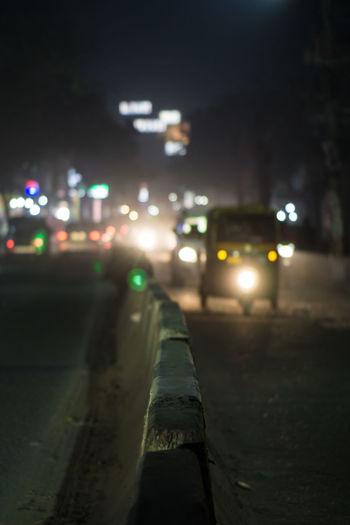Close-up of illuminated street at night