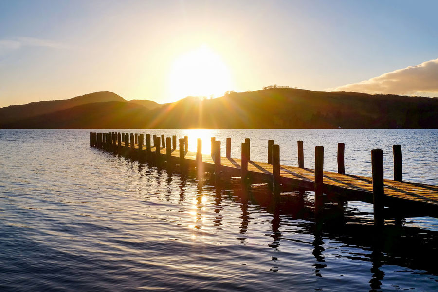 Lake District Lake District National Park Peaceful View Beauty In Nature Coniston Coniston Water Day Jetty View Lake Lake View Lens Flare Mountain Mountain Range Nature No People Outdoors Reflection Scenics Sky Sun Sunlight Sunset Tranquil Scene Tranquility Water