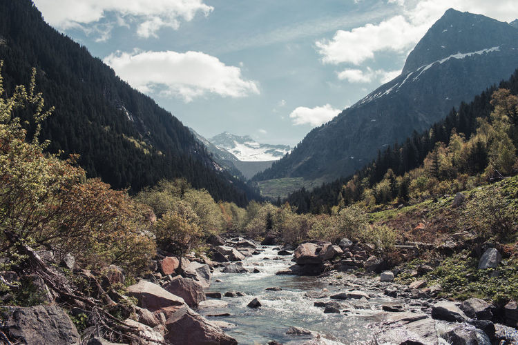 View of river passing through mountains
