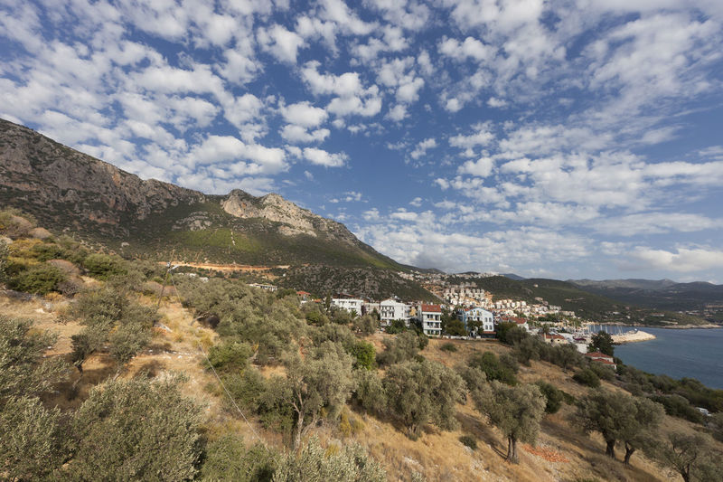 Panorama of Turkish Riviera and village Kas - Kas, Antalya Province, Turkey, Asia Antalya Architecture Building Building Exterior Cityscape Coast Coastal Feature Coastline Kas Landscape Landscape_Collection Landscape_photography Mediterranean  Mediterranean Sea No People Olive Tree Panorama Scenics Sea TOWNSCAPE Travel Destinations Turkish Turkish Riviera Village Wide Angle