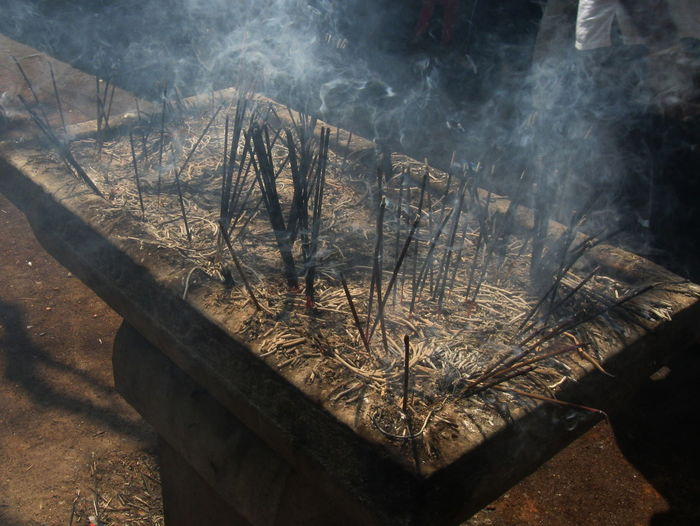 High Angle View Of Burning Incenses At Temple