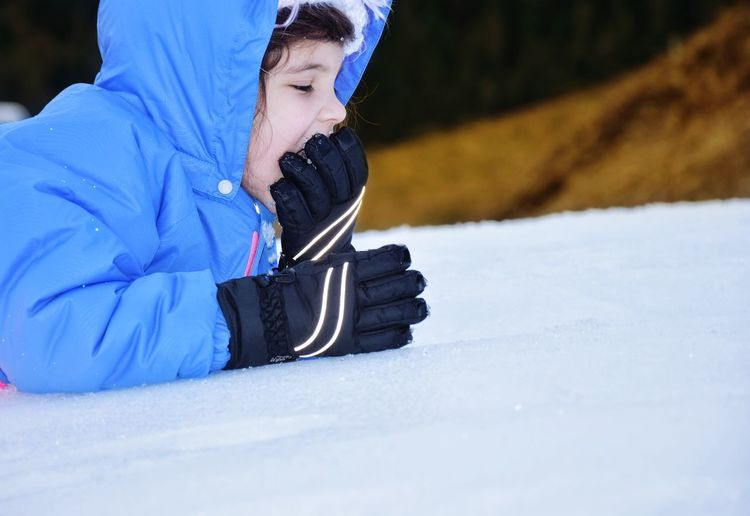 Thirsty?  Hungry? Eatingsnow EyeEm Selects Snow Cold Temperature Winter Child One Person Leisure Activity Warm Clothing Childhood Nature Day Glove Innocence Clothing