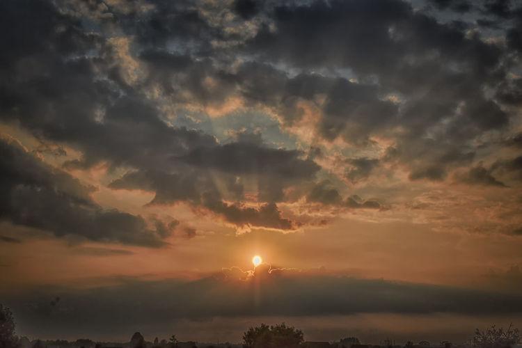 July Sunset Beauty In Nature Cloud - Sky Cloudscape Dramatic Sky Environment Idyllic Nature No People Non-urban Scene Orange Color Outdoors Scenics - Nature Sky Sun Sunbeam Sunlight Sunset Tranquil Scene Tranquility