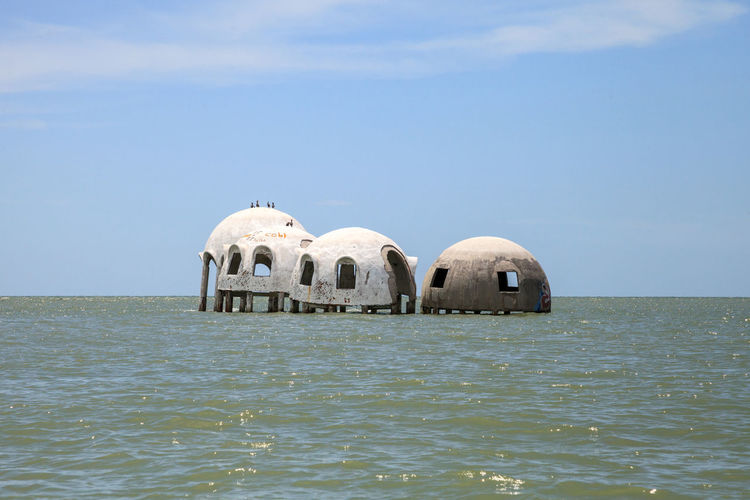 Blue sky over the Cape Romano dome house ruins in the Gulf Coast of Florida Coastline Nature Ocean View Ocean Views Ruins Abandoned Cape Romano Coast Coastal Day Dome Home Dome House Florida Landscape Marco Island Nature No People Ocean Outdoors Remote Rubble Sea Sky Water Wreckage