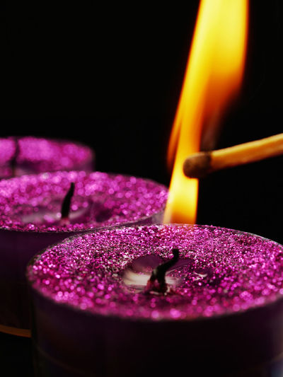 Lighting a glitter candle Candle Candles Candlelight Purple Close-up Flame Flames Burning Tealights Tea Lights Christmas Lights Christmas Ignite Kerze Kerzenlicht Flamme Lilac Lila Close Up Closeup Xmas The Culture Of The Holidays