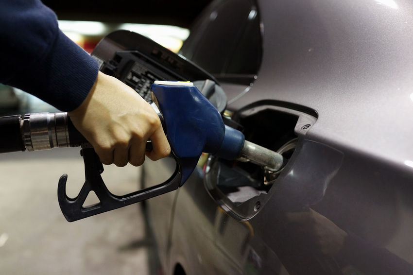 Refueling Car Close-up Consumerism Day Filling Finger Fuel And Power Generation Fuel Pump Gas Station Gasoline Hand Holding Human Body Part Human Hand Land Vehicle Men Mode Of Transportation Motor Vehicle One Person Refueling Transportation