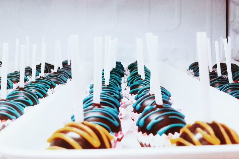 Close-up of candles on pastries