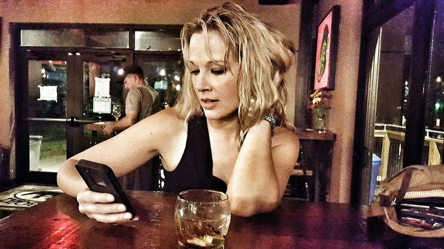 Woman sitting in restaurant