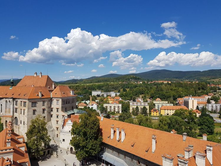 Cloudporn Peaceful Sunlight View From Above Tower Summer Tourist Tourist Attraction  UNESCO World Heritage Site Unesco Palaces Chesky Krumlov Chez Republic Cityscape Tiled Roof  City Tree Roof Town Residential Building Blue Old Town High Angle View TOWNSCAPE Rooftop Mountain Range