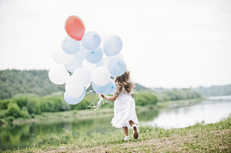 the river and girl Christening Green Run Running Balloon Balloons Childhood Christening 💙 Day Full Length Girls Hairstyle Land Leisure Activity Nature Plant Real People Sky The Great Outdoors - 2018 EyeEm Awards