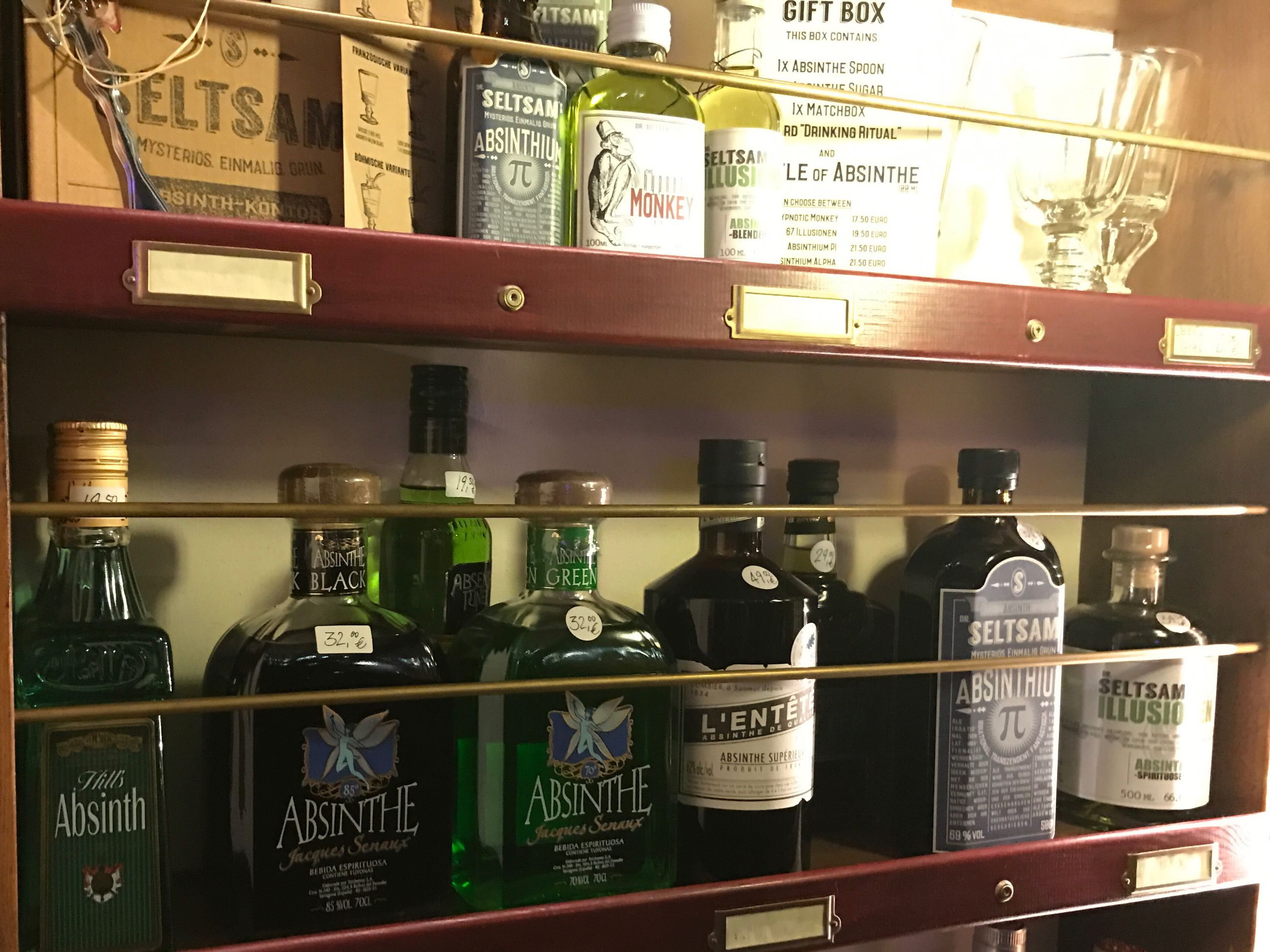 shelf, in a row, bottle, variation, choice, label, food and drink, no people, indoors, text, drink, medical cannabis, day