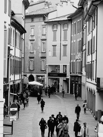 Bar Community Italy Urban Bkackandwhite Black And White Black & White City Downtown District Downtown People Streetphotography Street Photography Politics And Government City Police Force Men Women Architecture Building Exterior Built Structure Entryway