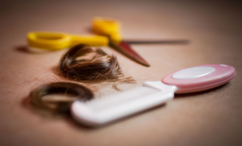 Extreme close-up of a comb, hair and cutting shears. Barber Beauty Brunette Close-up Coiffure👍 Cut Hair Extreme Close Up Fashion Fashion Game Hair Haircut Hairstyle Ideas Pink Plastic Play Salon Scissors Selective Focus Smooth Style Yellow