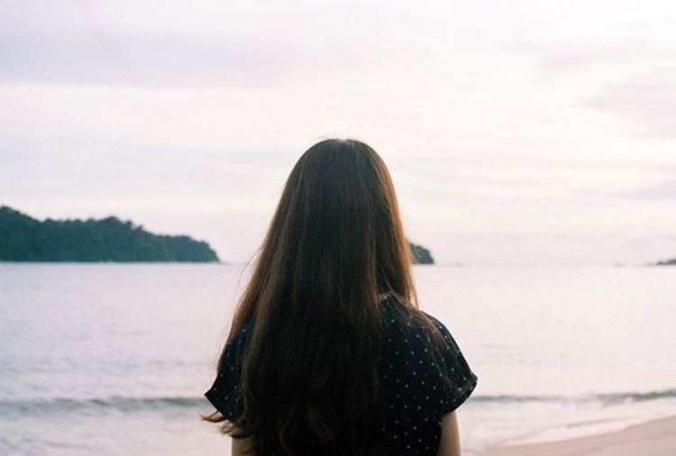 Only Women One Woman Only Long Hair Water Women One Young Woman Only Human Hair One Person Adults Only Beauty Rear View Adult Water's Edge People Young Adult Human Body Part Leisure Activity Relaxation Sea Sky