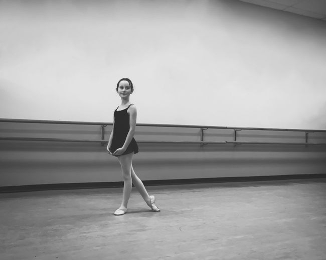 Side View Of Girl Practicing Ballet At Studio