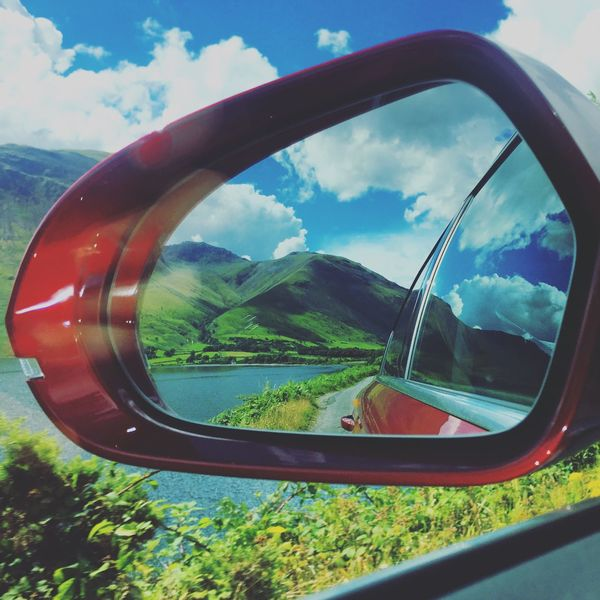 Breathing Space Side-view Mirror Sky Reflection Transportation Tree Land Vehicle Road Cloud - Sky Day Mode Of Transport No People Car Nature Landscape Mountain Outdoors Grass Vehicle Part Vehicle Mirror Beauty In Nature