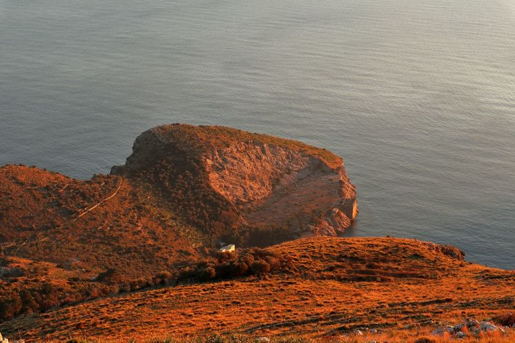 High angle view of rock formations on beach