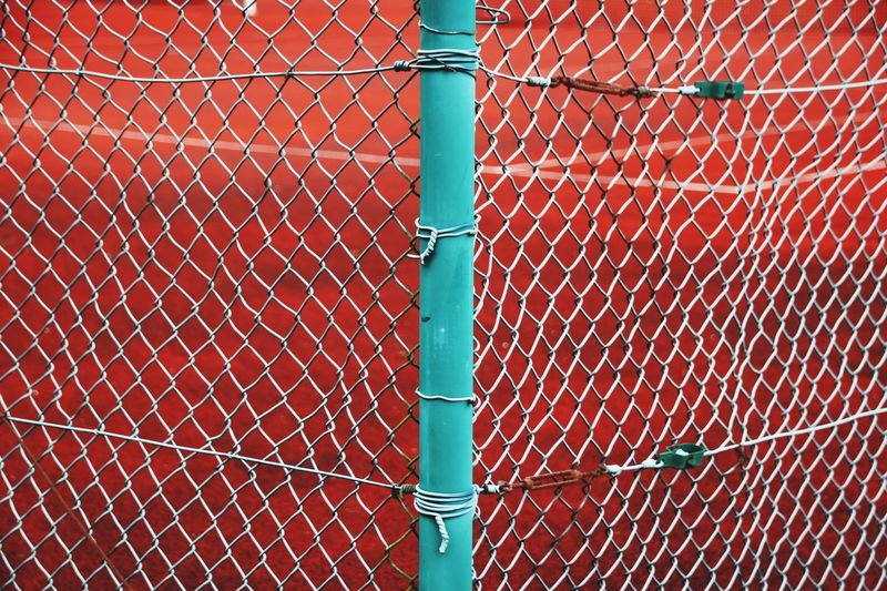Ace Tennis Tennis 🎾 Tenniscourt Tenniscourt Metal Full Frame No People Pattern Backgrounds Day Protection Fence Security Net - Sports Equipment Safety Boundary Close-up Outdoors Red Sport Orange Color