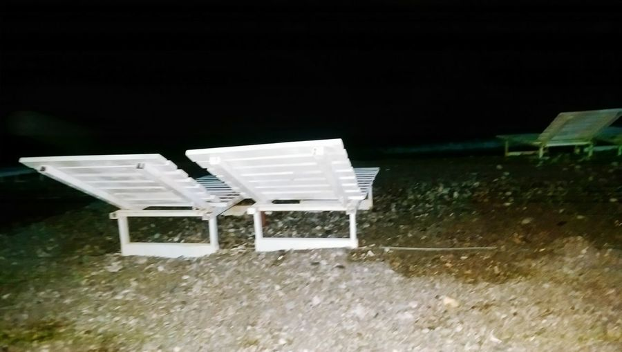 Empty benches in the dark