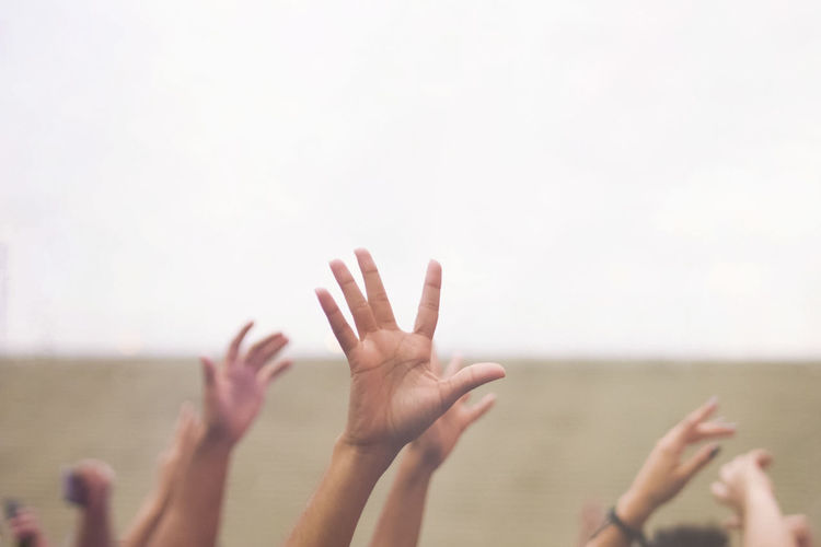 Adult Adults Only Arms Outstretched Arms Raised Close-up Day Focus On Foreground Gesturing Group Of People Human Arm Human Body Part Human Hand Limb Outdoors People Sky Stop Gesture Togetherness Women Young Adult