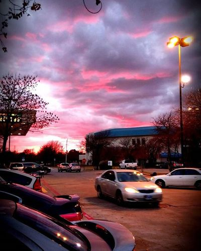 With a sky so vast we are still so confined by the hustle and bustle of society.... Sky Texassky Pink Sunset Wintersunset Cars Society Hustleandbustle Clouds CoolNight Vastsky